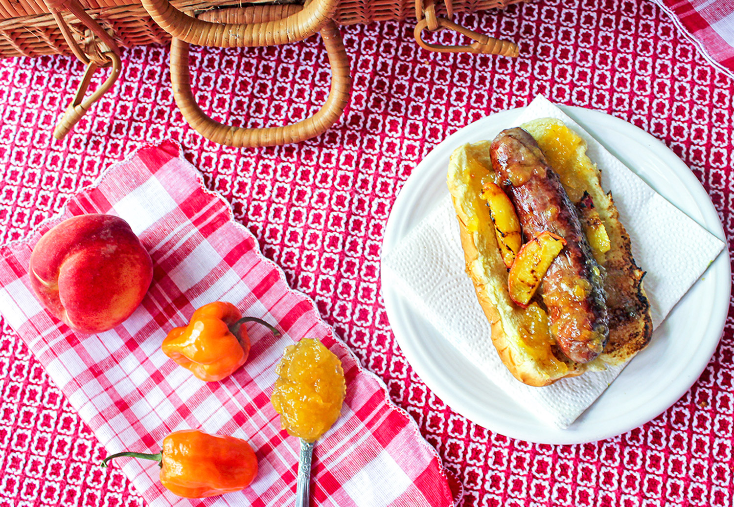 Hot dog with peach habanero jam and grilled peaches