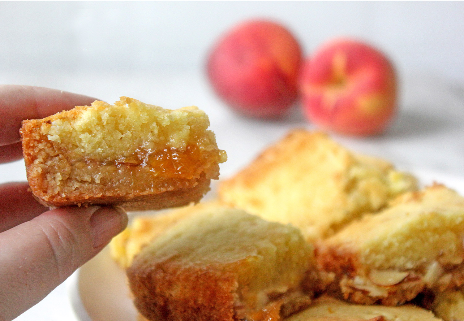 Peach Cobbler Jam Bars Recipe on Plate with Peaches