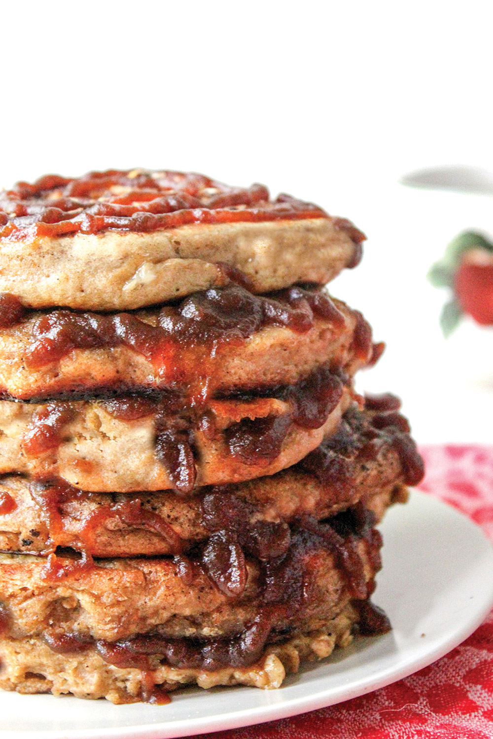 Stack of apple butter pancakes with struesel topping and apple butter