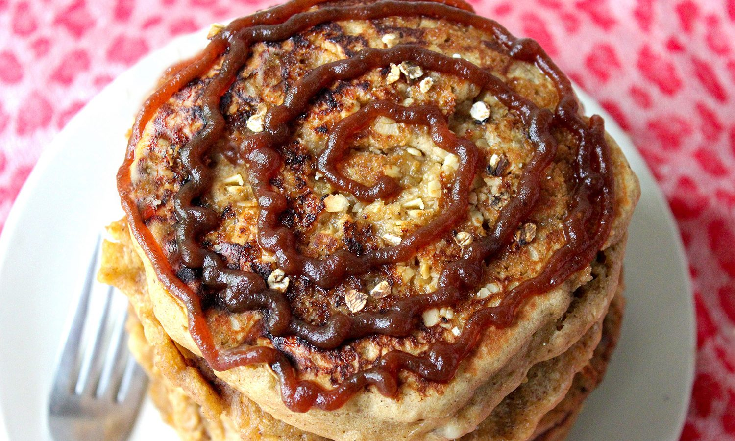 Spiced apple butter pancakes stack with a spiral of apple butter on top