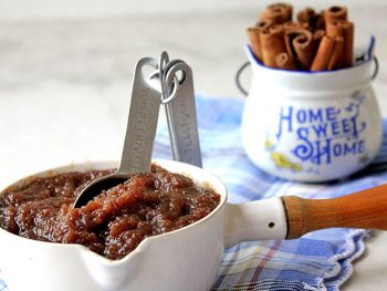 Cinnamon Apple Butter in a white measuring cup
