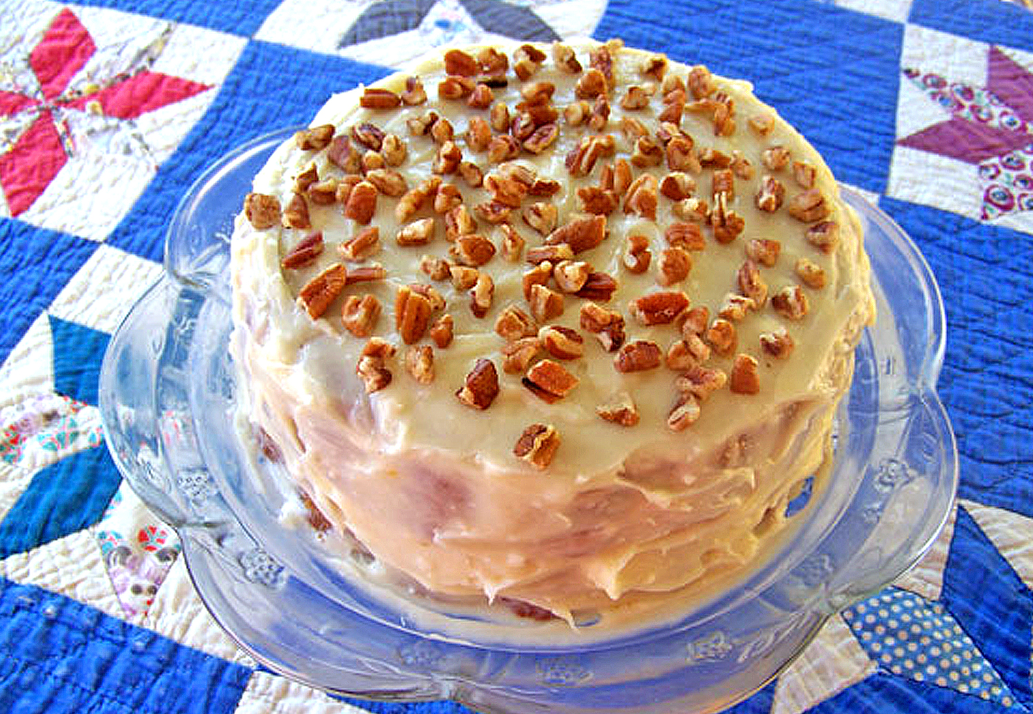 Pawpaw cake with frosting and nuts