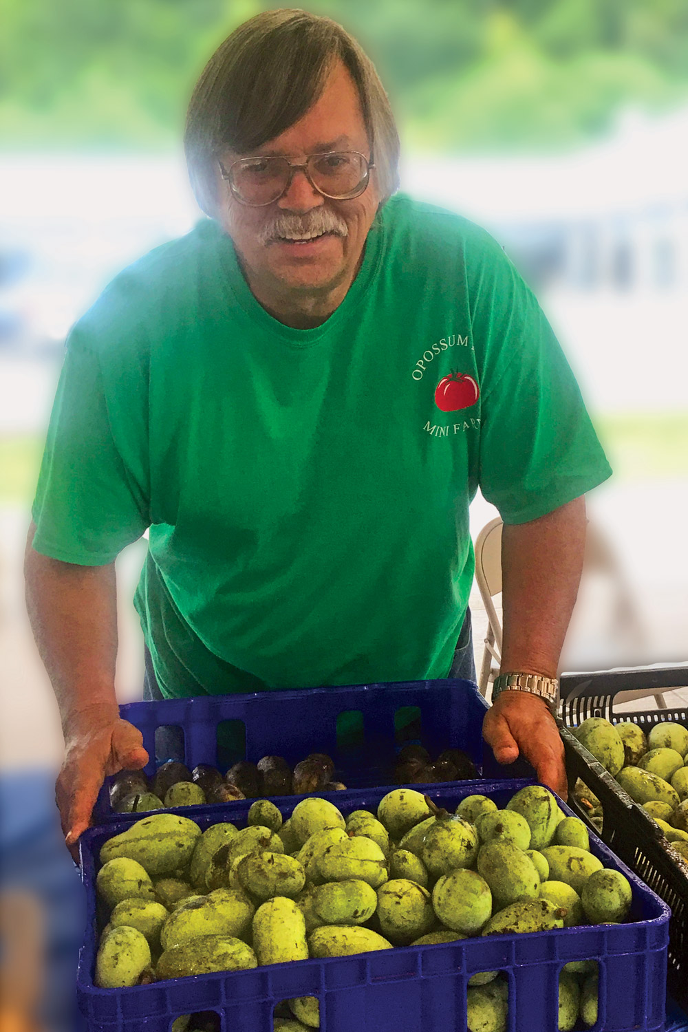 Irvin Coleman with pawpaws at the Pikeville Farmers Market