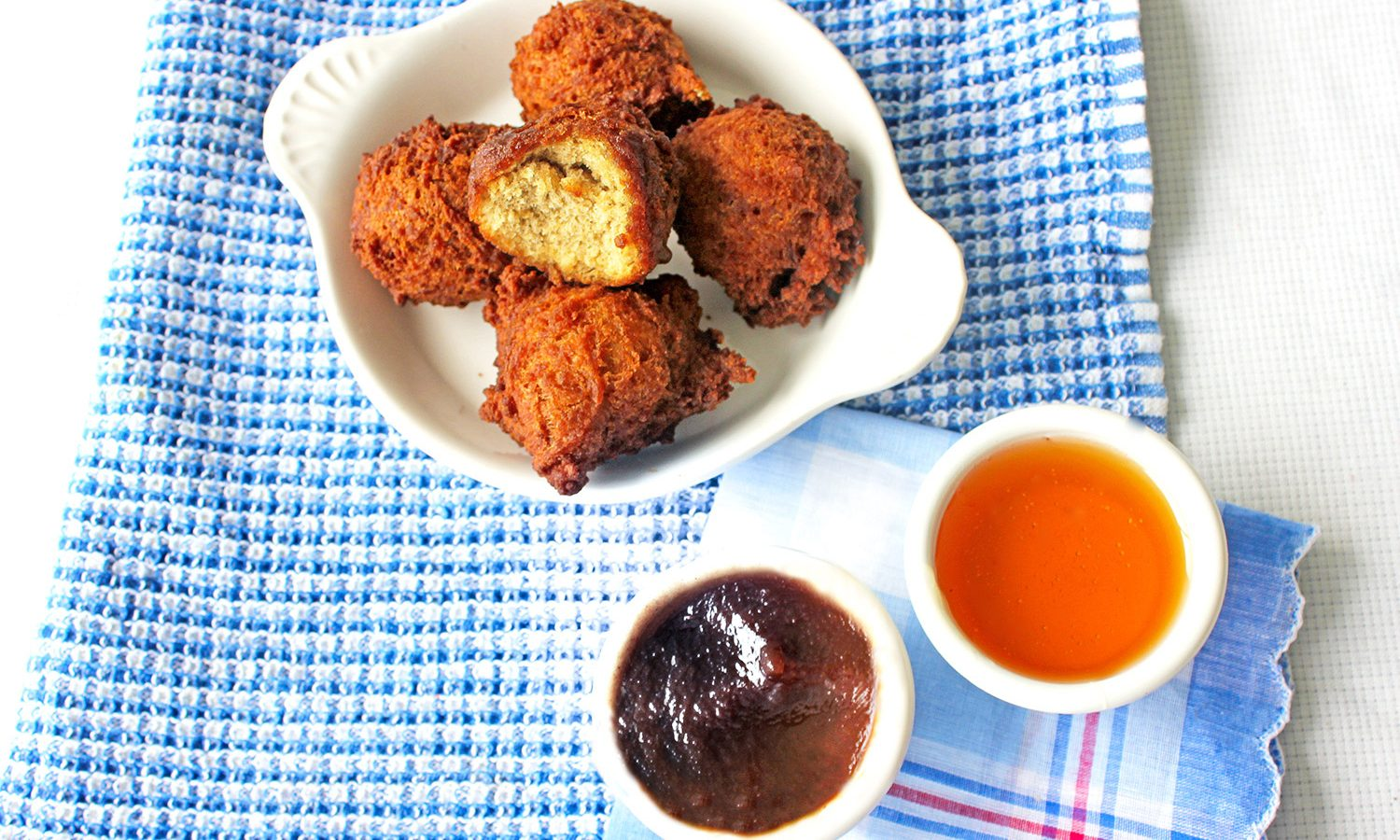 Apple Fritter Bites with dipping bowls of apple butter and honey