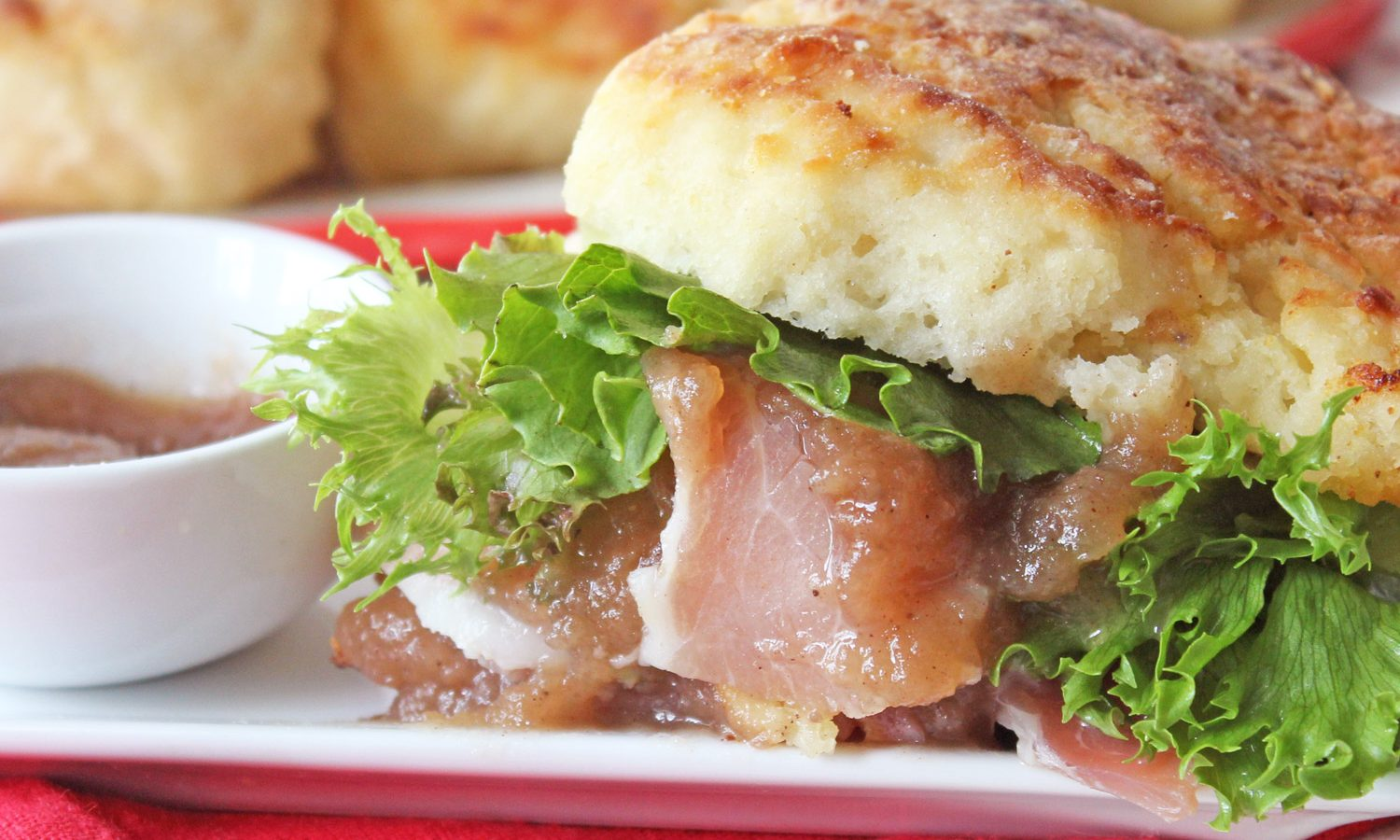 Apple Butter Ham Biscuits with fresh greens