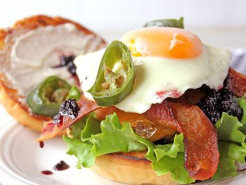 Burger and egg with blackberry jam, bacon, and jalapeno peppers