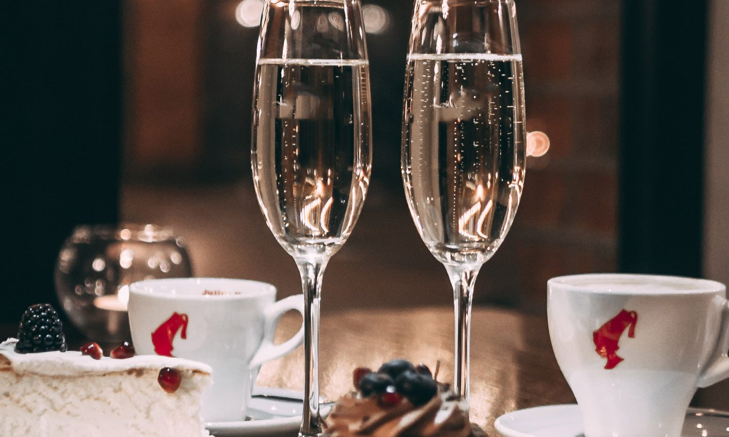 Two champagne glasses with desserts