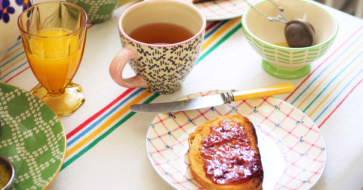 Table with jam, toast, and tea