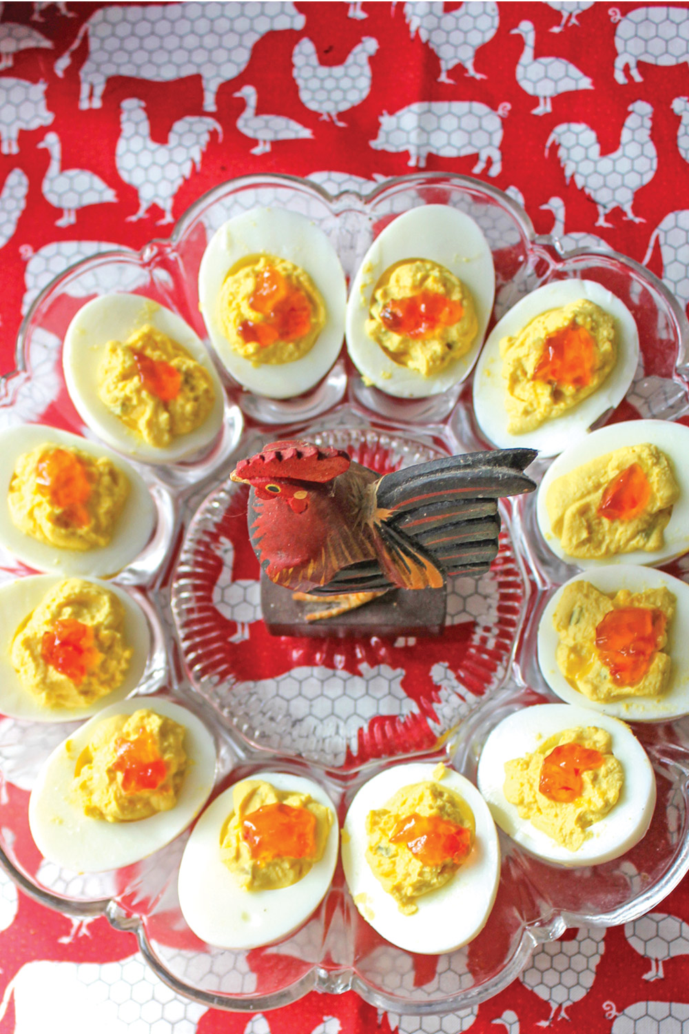 Load up the party tray with  deviled eggs featuring dollops of red pepper jelly