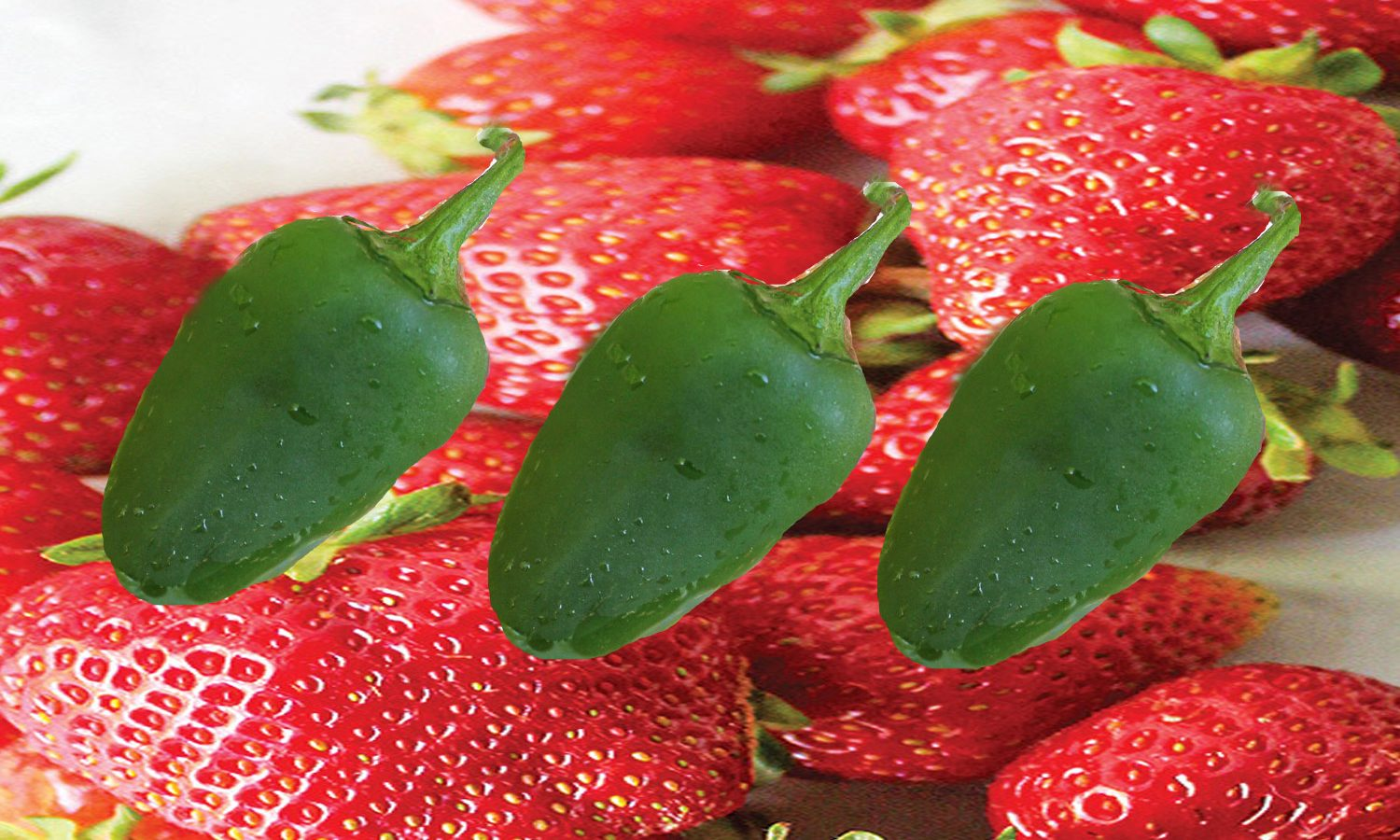 Jalapeno Peppers superimposed over fresh strawberries