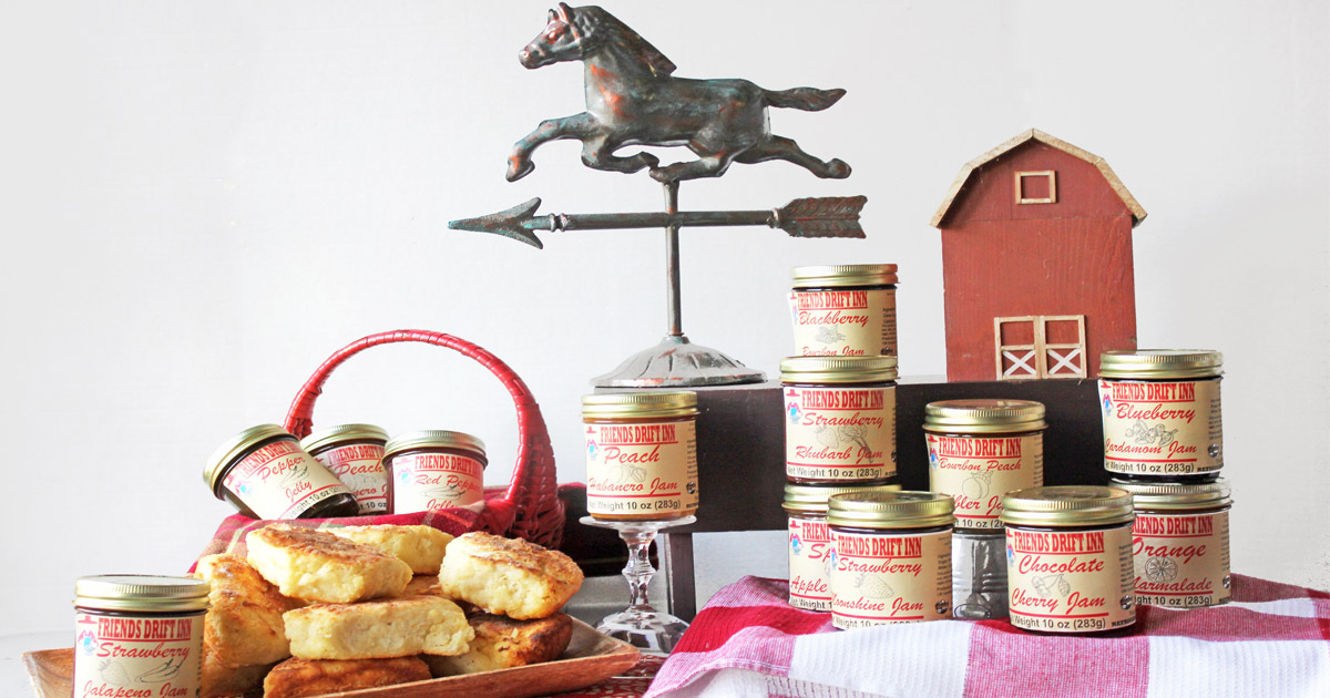 Friends Drift Inn Jams with biscuits, weathervane and red barn on table