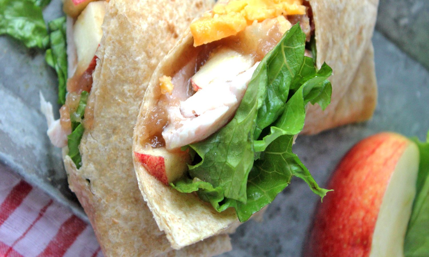 Turkey wrap recipe featuring fresh apples, apple butter and cheddar cheese.