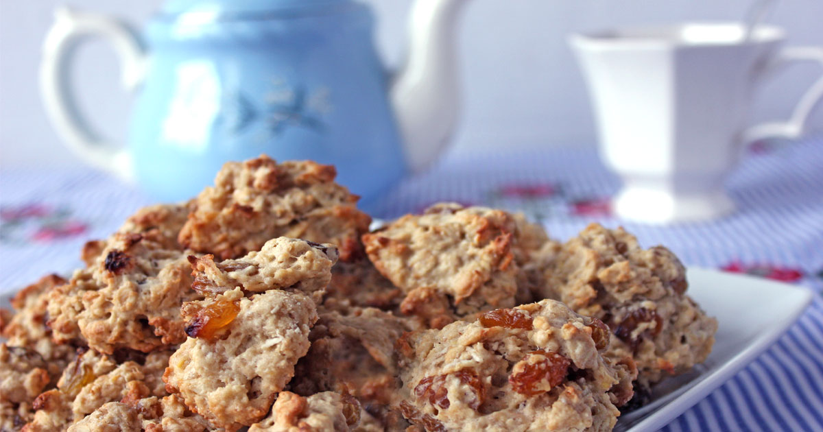 Plate of oatmeal raising cookies with blue teapot