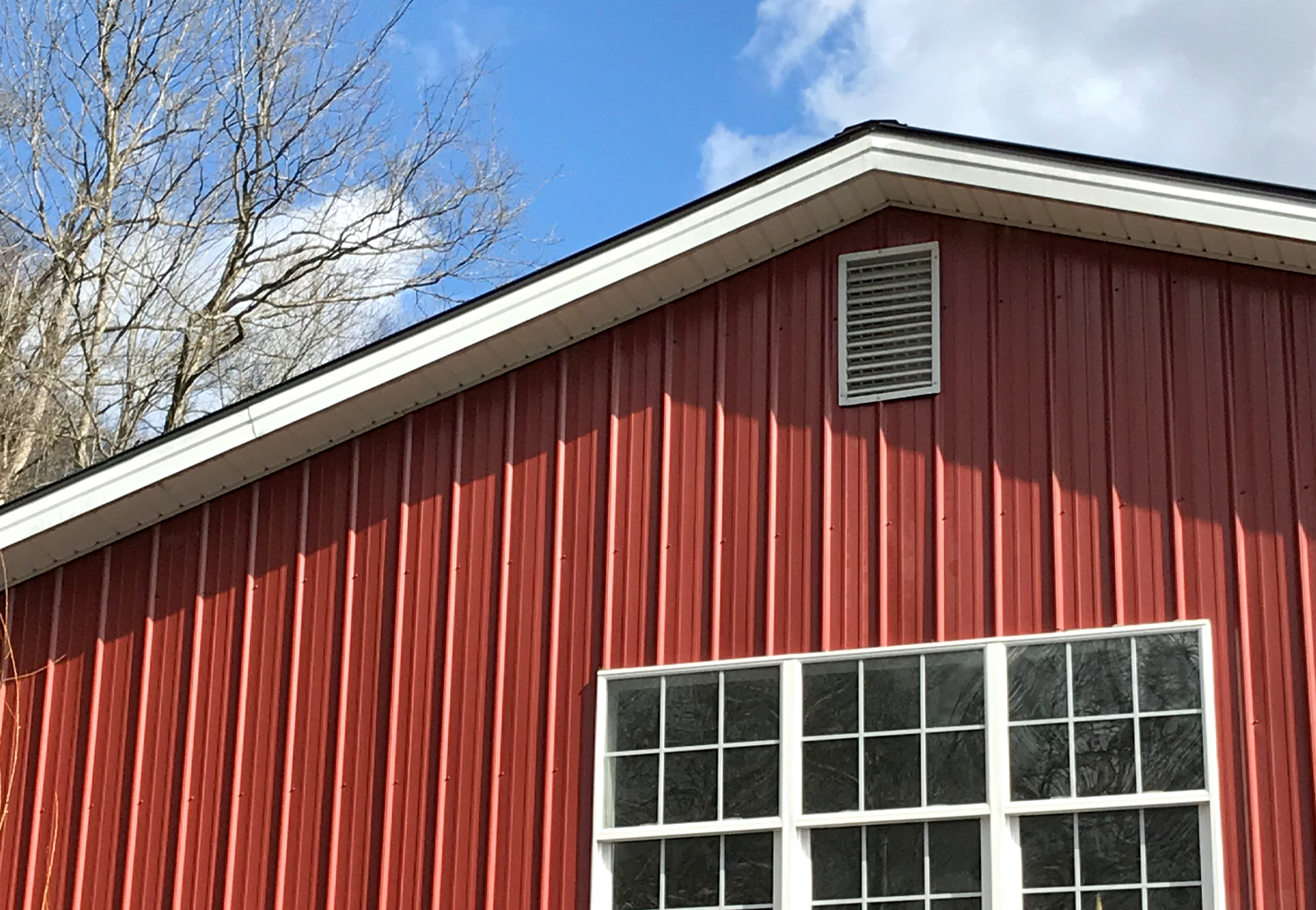 Friends Drift Inn big red barn with spring skies so blue!